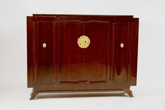 Cabinet with cast-bronze medals